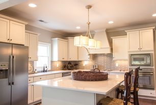 Modern Kitchen with Corian counters, Freestanding Full Size Top Freezer Refrigerator, Subway Tile, Standard height, Wall Hood