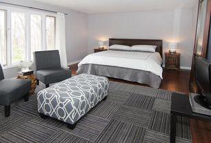 Contemporary Master Bedroom with Casement, Hardwood floors, Standard height, Paint 2