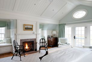 Traditional Master Bedroom with Cathedral ceiling, French doors, can lights, Hardwood floors, Wainscotting, brick fireplace