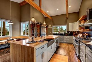 Country Kitchen with Kitchen island, can lights, European Cabinets, gas range, Wood counters, Wall Hood, High ceiling, Flush