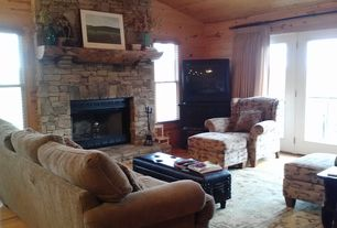 Rustic Living Room with French doors, Fireplace, Ceiling fan, stone fireplace, Hardwood floors, double-hung window