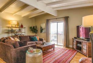 Modern Living Room with Standard height, Hardwood floors, Built-in bookshelf, Exposed beam, sliding glass door