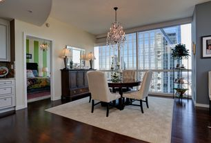 Traditional Dining Room with Standard height, Chandelier, picture window, Hardwood floors