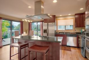 Contemporary Kitchen with Pendant light, Breakfast bar, Island Hood, built-in microwave, Standard height, Soapstone, Flush