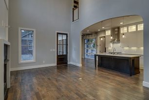 Traditional Living Room with Hardwood floors, insert fireplace, double-hung window, High ceiling, Fireplace, Balcony