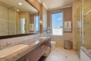 Modern Full Bathroom with drop in bathtub, Bathtub, Standard height, Limestone Tile, Double sink, can lights, full backsplash