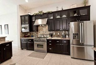 "Traditional Kitchen with Complex Granite, 12"" x 12"" ceramic tile, gas range, Multiple Refrigerators, Wall Hood, Raised panel"