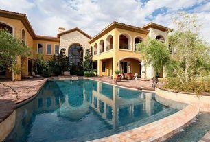 Mediterranean Swimming Pool with Lap pool, exterior brick floors