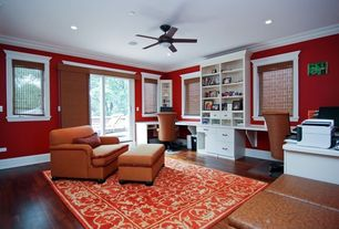 Traditional Home Office with Hardwood floors, Built-in bookshelf, flush light, Ceiling fan, Crown molding, French doors