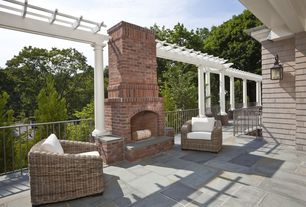Traditional Porch with exterior stone floors, Trellis, outdoor pizza oven