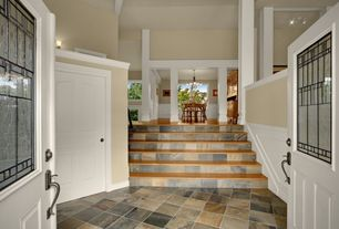 Traditional Staircase with Wall sconce, French doors, Columns, Floating staircase, Wainscotting, slate floors, High ceiling