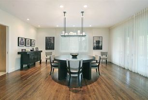 Contemporary Dining Room with Hardwood floors