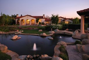 Mediterranean Exterior of Home with Exterior of house, Gazebo, Naturalistic pool, Arched window, Water feature, French doors