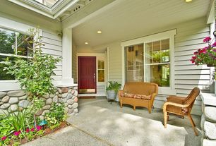 Country Porch with exterior stone floors, Glass panel door, Wrap around porch