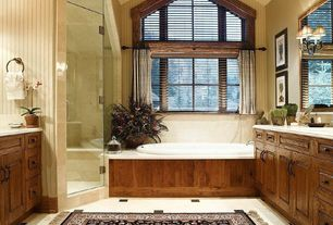 Craftsman Master Bathroom with Simple marble counters, Bathtub, Wall sconce, picture window, Simple Marble, drop in bathtub