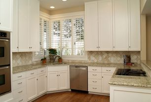 Traditional Kitchen with double wall oven, Simple granite counters, Frameless, Simple Granite Tile, specialty window