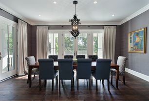 Traditional Dining Room with interior wallpaper, French doors, Crown molding, Pendant light, Hardwood floors