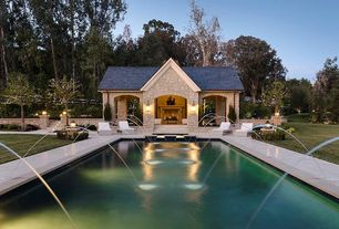 Traditional Swimming Pool with Pool with hot tub, Fountain, Fence