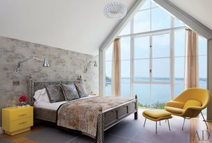 Contemporary Master Bedroom with interior wallpaper, Built-in bookshelf, Pendant light, Laminate floors, Cathedral ceiling