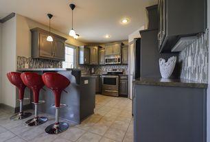 Modern Kitchen with Ceramic Tile, limestone tile floors, U-shaped, Simple granite counters, Breakfast bar, flush light
