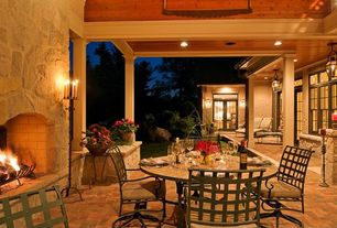 Traditional Porch with Wrap around porch, French doors, Transom window, exterior brick floors