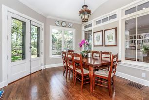 Traditional Dining Room with picture window, Casement, Crown molding, Glass panel door, flush light, Hardwood floors