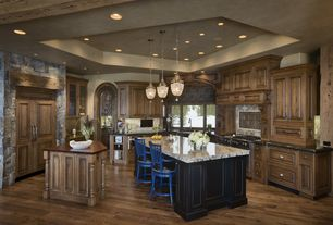 Rustic Kitchen with Breakfast bar, Complex granite counters, Built In Panel Ready Refrigerator, full backsplash, U-shaped