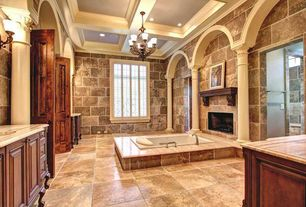 Mediterranean Master Bathroom with Wall sconce, stone tile floors, Bathtub, drop in bathtub, Master bathroom, Wall Tiles