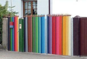Eclectic Landscape/Yard with Colorful, Custom carved wood, Street art, Wood fence, Colored pencil fence, Gate, Kids