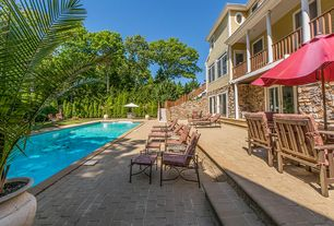 Traditional Swimming Pool with Lap pool, Raised beds, Fence, exterior stone floors, Pathway