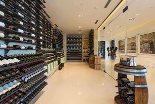 Modern Wine Cellar with simple marble tile floors, Built-in bookshelf