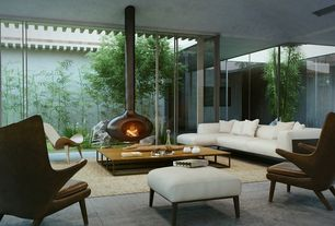 Contemporary Living Room with Wood Stove fireplace, Concrete floors, picture window, Fire orb, Fire orb suspended fireplace