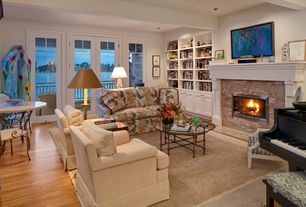 Traditional Living Room with can lights, Standard height, Fireplace, Built-in bookshelf, picture window, Hardwood floors