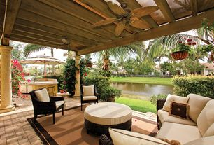 Tropical Porch with exterior awning, exterior stone floors, Outdoor kitchen