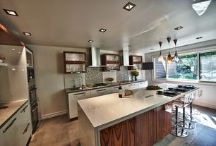 Contemporary Kitchen with Breakfast bar, European Cabinets, L-shaped, Limestone Tile, Stone Tile, Undermount sink, Flush