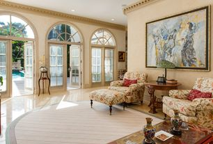Traditional Living Room with Arched window, can lights, French doors, Standard height, Crown molding, sandstone floors