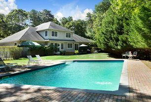 Traditional Swimming Pool with French doors, exterior brick floors, Outdoor kitchen