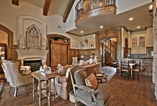 Country Living Room with Built-in bookshelf, Chair rail, Hardwood floors, Wall sconce, Cathedral ceiling, Loft, Exposed beam