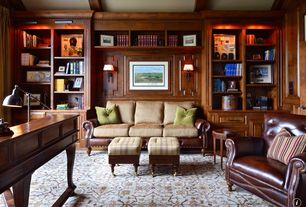 Traditional Library with Built-in bookshelf, Wall sconce, bedroom reading light, Exposed beam, Standard height