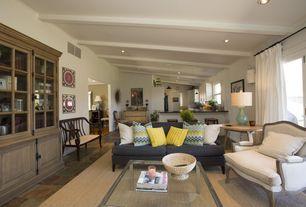 Contemporary Great Room with Crown molding, Standard height, Built-in bookshelf, Pendant light, Exposed beam, Sunburst mirror