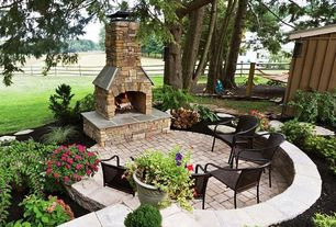 Traditional Patio with outdoor pizza oven, exterior brick floors, Fence, Raised beds, Pathway
