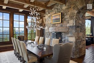 Rustic Dining Room with High ceiling, Chandelier, picture window, 19th c. slope arm dining chair, Exposed beam, can lights