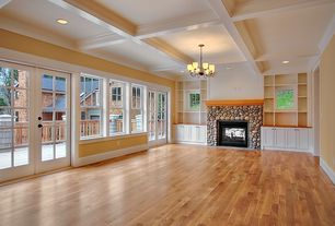Traditional Great Room with Exposed beam, Chandelier, French doors, Built-in bookshelf, Hardwood floors, Box ceiling