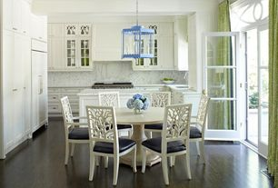 Traditional Dining Room with Crown molding, Pendant light, Built-in bookshelf, Hardwood floors, French doors, Transom window