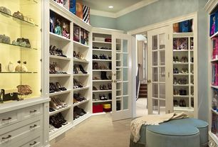 Traditional Closet with Walk in closet, Woman's shoe storage open shelving, Carlyle Clover Leaf Ottoman, French doors, Carpet