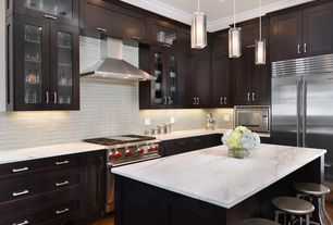 Contemporary Kitchen with Glass panel, Crown molding, Shades of light double cylinder glass pendant, Glass Tile, Flush