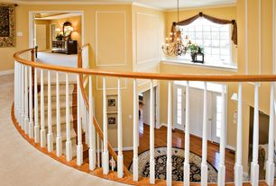 Traditional Entryway with Hardwood floors, Crown molding, Transom window, picture window, Balcony, Stair runner, Chandelier