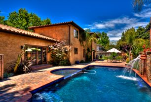 Mediterranean Swimming Pool with exterior brick floors, French doors, Fence, Fountain