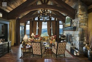 Traditional Living Room with specialty window, Fireplace, Chandelier, stone fireplace, French doors, picture window, Columns