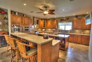 Tropical Kitchen with Breakfast bar, Glass panel, Limestone, Raised panel, limestone tile floors, Undermount sink, Flush